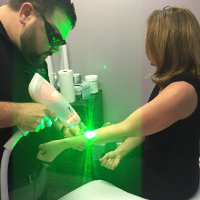 green laser beam on arm